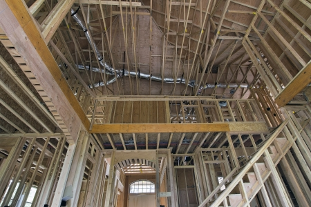 studs: Wood Studs Framing for Two-Storey Home with High Ceiling in Living Room with Staircase