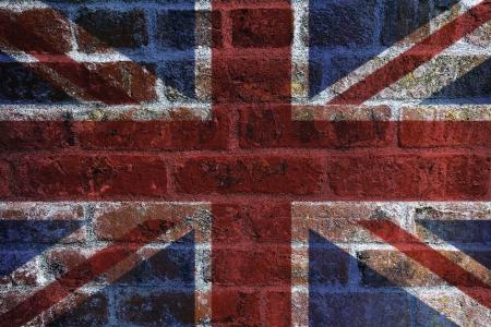 grunge layer: UK England Union Jack Flag on Textured Grunge Brick Wall Background