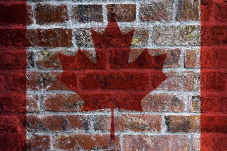 Canadian Flag on Textured Grunge Brick Background photo