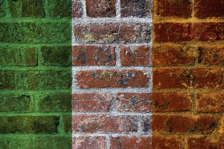 irish pride: Ireland Flag on Textured Grunge Brick Wall Background Stock Photo