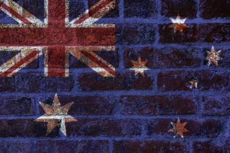 wales: Australian Flag with Union Jack on Textured Grunge Brick Wall Background