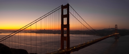 north gate: Sunrise Over San Francisco City Skyline from Golden Gate Bridge Panorama Stock Photo