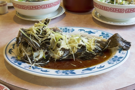 Steamed Whole Fish Chinese Dish with Ginger Scallions and Soy Sauce