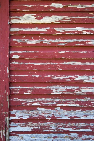 house siding: Old Red Barn with Peeling Paint Grunge Background Stock Photo