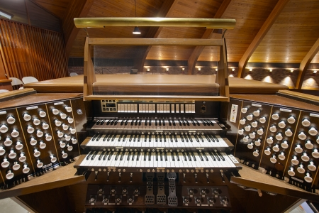 Church Pipe Organ Keyboards Pedalboard and Control Buttons Stock Photo