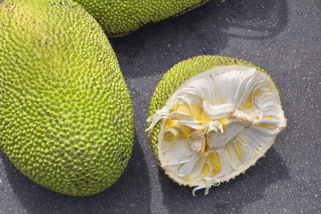 flesh: Jackfruit Whole and Open with Yellow Flesh for Sale at Outdoor Wet Market in Southeast Asia Stock Photo