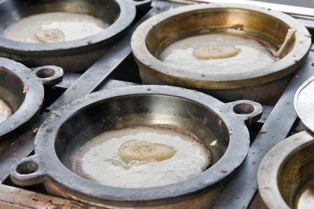 Making of Kueh Apom Balik Turnover Pancake with Banana in Brass Mold Pan at Local Food Hawker Stall in Penang Malaysia Reklamní fotografie
