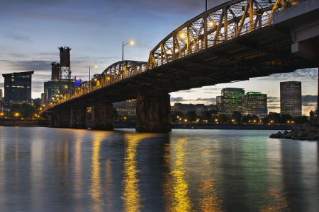 hawthorne: Portland Oregon City Skyline Under Hawthorne Bridge by the Bank of Willamette River at Dusk Stock Photo