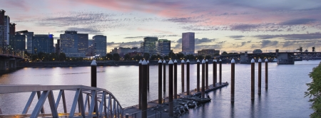 eastbank: Portland Oregon Waterfront Skyline by the Boat Dock Along Willamette River at Sunset Panorama