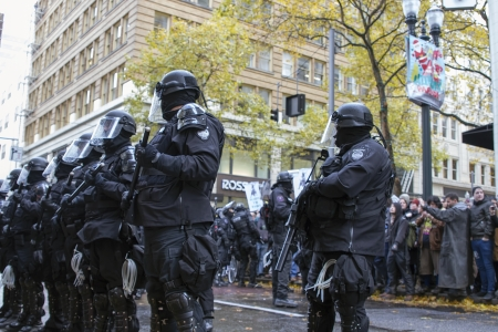 occupy wall street: PORTLAND, OREGON - NOV 17  Police Sheriff in Riot Gear Frontline in Downtown Portland, Oregon during a Occupy Portland protest on the first anniversary of Occupy Wall Street November 17, 2011
