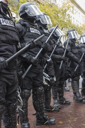 PORTLAND, OREGON - NOV 17  Police in Riot Gear Frontline in Downtown Portland, Oregon during a Occupy Portland protest on the first anniversary of Occupy Wall Street November 17, 2011 新闻类图片