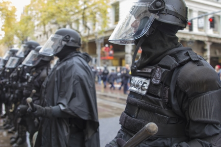 occupy wall street: PORTLAND, OREGON - NOV 17  Police in Riot Gear in Downtown Portland, Oregon during a Occupy Portland protest on the first anniversary of Occupy Wall Street November 17, 2011