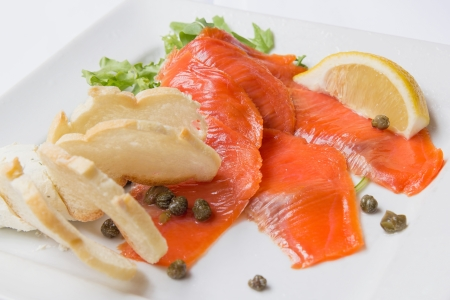 Smoked Salmon with Capers Lemon Salad and Bread Closeup