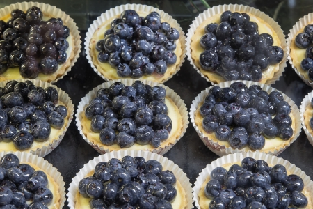 Lemon Curd Fruit Tarts with Blueberries at Bakery Shop
