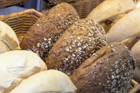 flaxseed: Multi Grain Bagels at Bakery Shop Closeup Stock Photo