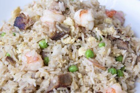 Yeung Chow Fried Rice with Barbecued Pork Prawns Green Peas Scallions and Eggs Closeup Macro photo