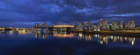 bc: Vancouver BC Canada Downtown City Skyline by False Creek at Evening Blue Hour Panorama