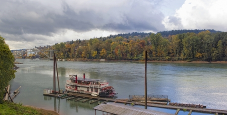 linn: Historic Sternwheeler Docked Along Willamette River in Oregon City in Fall Season Panorama