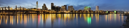 Portland Oregon Waterfront City Downtown and Bridges Along Willamette River from Eastbank Esplanade at Evening Blue Hour photo