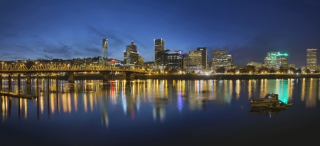 eastbank: Portland Oregon Downtown Skyline with Hawthorne Bridge Along the Banks of Willamette River at Evening Blue Hour Panorama Stock Photo