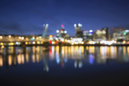 out of focus: Out of Focus Portland Oregon Skyline with Hawthorne Bridge and Willamette River City Lights Reflection at Blue Hour Stock Photo