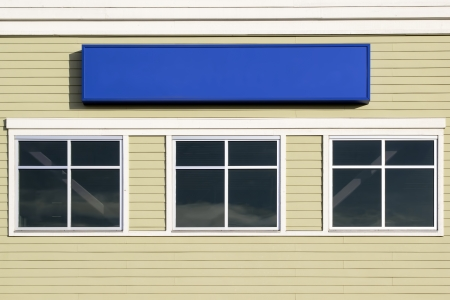 Blank Sign Above Windows Outside For Commercial Hospital Clinic or Business Office Building Stock Photo
