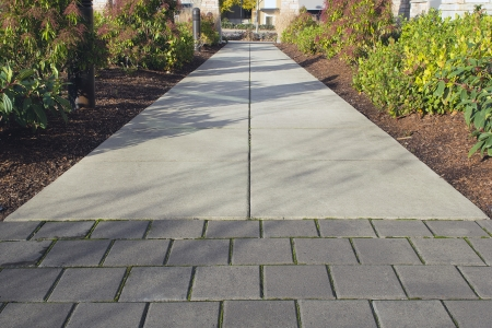 pavers: Commercial Outdoor Space Sidewalk Landscaping with Walk Path and Plants Stock Photo