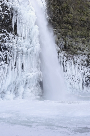 horsetail: Frozen Pool with Icicles at Horsetail Falls at Columbia River Gorge Oregon in Winter Stock Photo