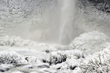 Base of Latourell Falls at Columbis River Gorge Oregon Frozen in WInter with Icicles and Snow in Winter Closeup photo
