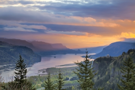 Sunrise Over Vista House on Crown Point at Columbia River Gorge in Oregon with Beacon Rock in Washington State Stock Photo
