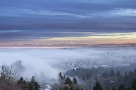 portland oregon: Portland Oregon Downtown Cityscape Covered in Fog and Low Clouds at Sunset with Mount Hood