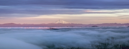 alpenglow: Portland Oregon Downtown Covered in Fog at Sunset with Mount Hood Panorama Stock Photo