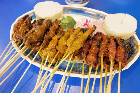 Satay Chicken Beef and Mutton with Cucumbers Onions and Rice Cake