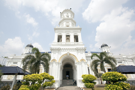 Sultan Abu Bakar State Mosque Building Front Entrance Against Cloudy Blue Sky in Johor Bahru Stock Photo