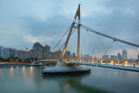 Suspension Bridge Over Geylang River at Tanjong Rhu in Singapore at Evening Blue Hour Stock Photo - 25990360