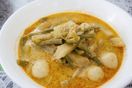 Lontong Sayur Lodeh Indonesian Gravy Dish with Cabbage String Beans and Fishballs Closeup