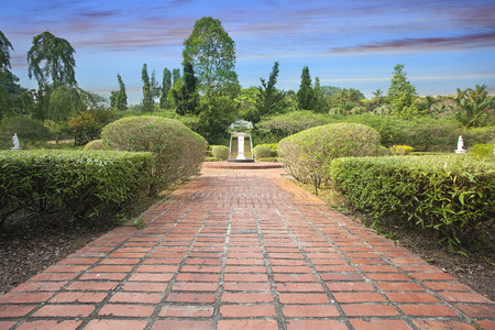 hardscape: Formal Garden Brick Path with Trees Plants and Water Fountain