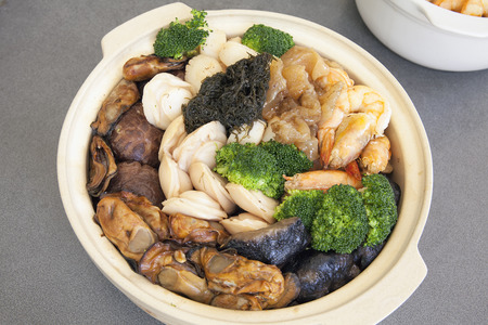 feast: Poon Choi Hong Kong Cantonese Cuisine Big Feast Bowl  with Seafood and Vegetables for Chinese New Year Dinner Stock Photo