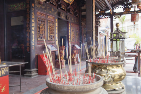 Burning Joss Sticks on Large Urns as Offerings to Chinese Gods at Chinese Temple in Malacca Malaysia photo