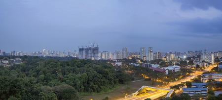 Singapore Cityscape with Housing Estate Condominiums Apartment Buildings and Central Business District in the Distant at Blue Hour Panorama  photo