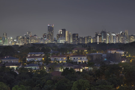 private property: Singapore Private Homes with Central Business District CBD Skyline inthe Background at Night