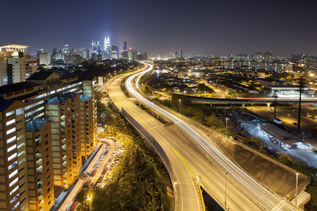 Ampang Kuala Lumpur Elevated Highway AKLEH with City Skyline in Malaysia at Dusk