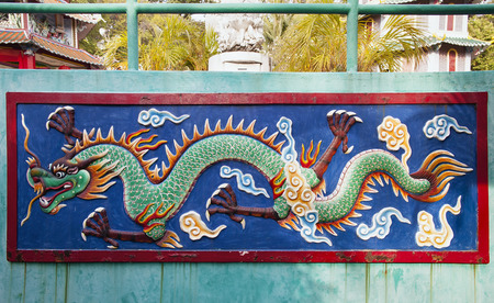 par: SINGAPORE - FEBRUARY 1, 2014  Colorful Dragon Wall Relief Sculpture at Haw Par Villa Theme Park