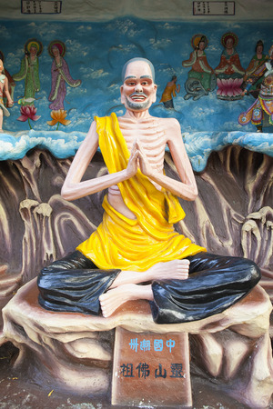 SINGAPORE - FEBRUARY 1, 2014: Ancient Chinese Living Buddha Ji Gong Statue Diorama at Haw Par Villa Theme Park