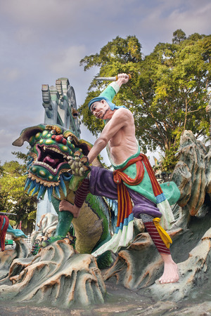diorama: SINGAPORE - FEBRUARY 1, 2014: Ancient Chinese Warrior Wu Song Slaying Tiger Statue Diorama at Haw Par Villa Theme Park Editorial