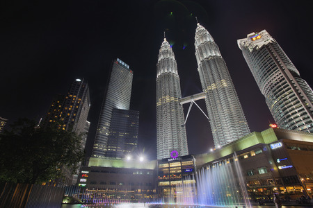KUALA LUMPUR, MALAYSIA - FEBRUARY 7, 2014 - Musical Water Fountain at Kuala Lumpur KLCC Park Twin Towers Petronas at Night  Petronas Twin Tower was the tallest buildings in the world from 1998 to 2004 until it was surpassed by Taipei 101  It remains the t