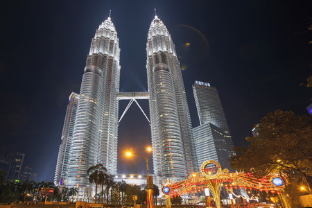 KUALA LUMPUR, MALAYSIA - FEBRUARY 3, 2014 - Holiday Decorations by Petronas Twin Tower Night Scene  Petronas Twin Tower was the tallest buildings in the world from 1998 to 2004 until it was surpassed by Taipei 101  It remains the tallest twin towers in th