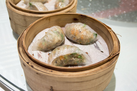 cloesup: Steamed Dumpling Chiu Chao Fan Guo with Pork Shrimp Peanuts Jicama and Cilantro in Bamboo Steamer Closeup up