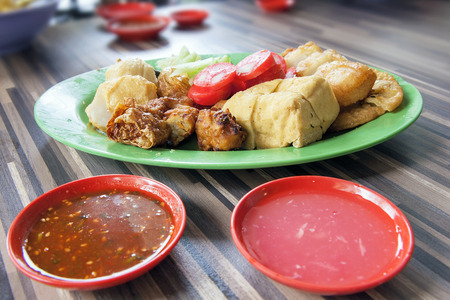 Ngo Hiang Five Spice Powder Seasoned Fried Sausages Tofu Fishballs Preserved Century Eggs and Dipping Sauces Local Dish photo