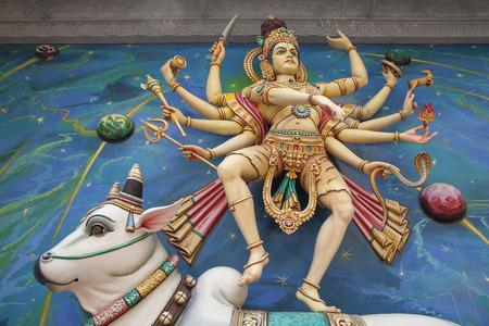 Nataraj Dancing Form of Lord Shiva Hindu God Standing on Sacred Cow on Temple Exterior Wall